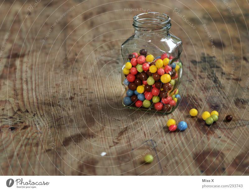 candy jar Lebensmittel Süßwaren Schokolade Ernährung klein lecker rund süß mehrfarbig Schokolinsen Holztisch Glas Behälter u. Gefäße aufbewahren Zutaten
