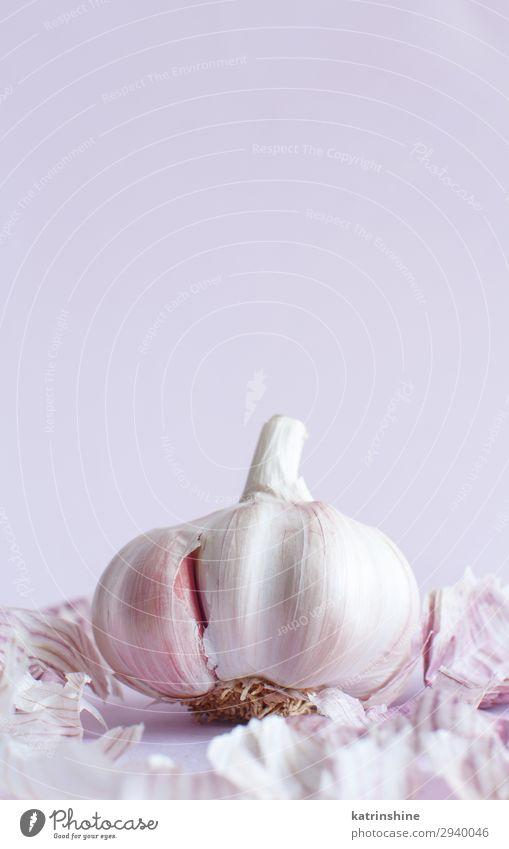 Frischer Knoblauch auf pastellfarbenem Hintergrund Gemüse Kräuter & Gewürze Vegetarische Ernährung frisch Verfall Knolle ingrerient hellrosa Gewürznelke Pastell