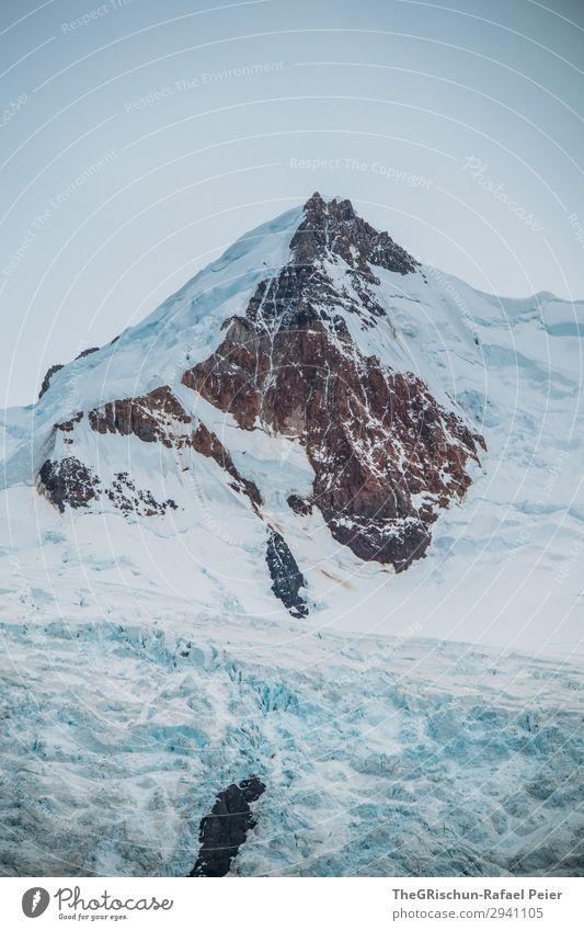 Gletscherberg Natur blau braun schwarz weiß Berge u. Gebirge Felswand Schnee Wolken schmelzen kalbern Argentinien Patagonien Farbfoto Außenaufnahme Menschenleer