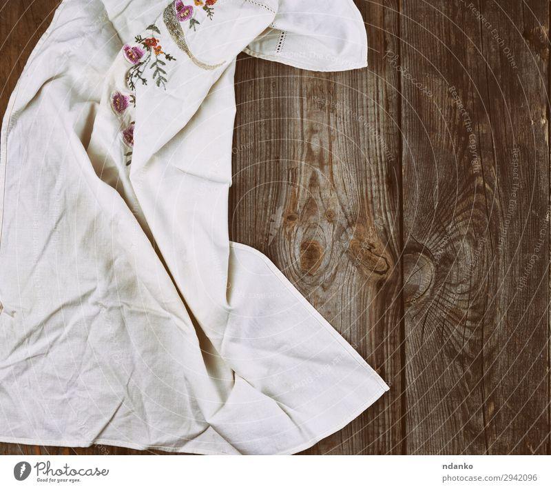 Textilgeschirrtuch auf Holzuntergrund Design Tisch Küche Stoff alt retro Sauberkeit weich grau weiß Textfreiraum Hintergrund blanko Leinwand Baumwolle Deckung
