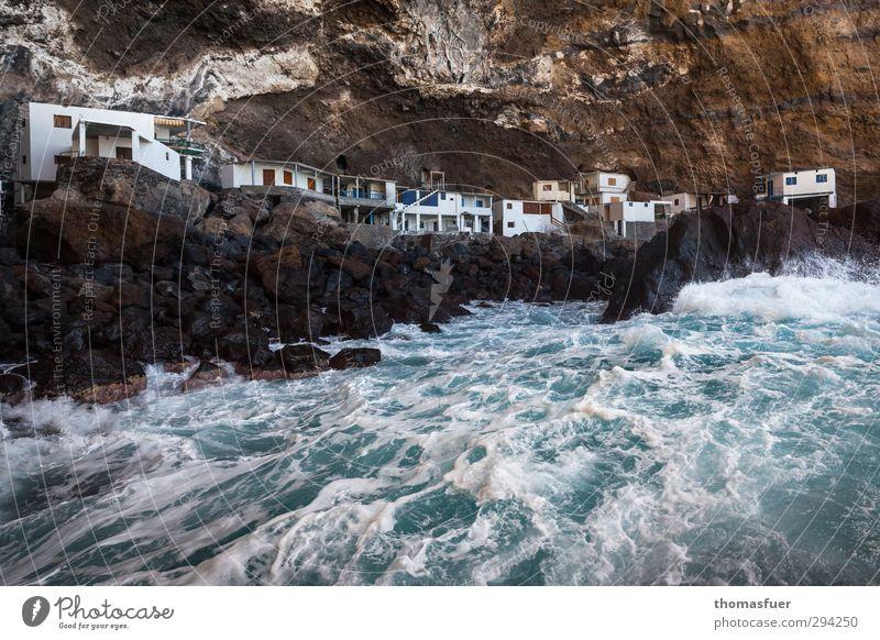 Freihandelszone blau Ferien & Urlaub & Reisen Wasser Meer Strand Haus Ferne Küste braun Felsen Wellen wild Erde Insel Schönes Wetter Tourismus