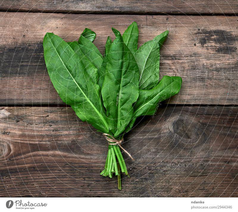 Bund frischer grüner Blätter vom Sauerampfer Gemüse Suppe Eintopf Kräuter & Gewürze Vegetarische Ernährung Tisch Seil Natur Pflanze Blatt Holz oben Sauerklee