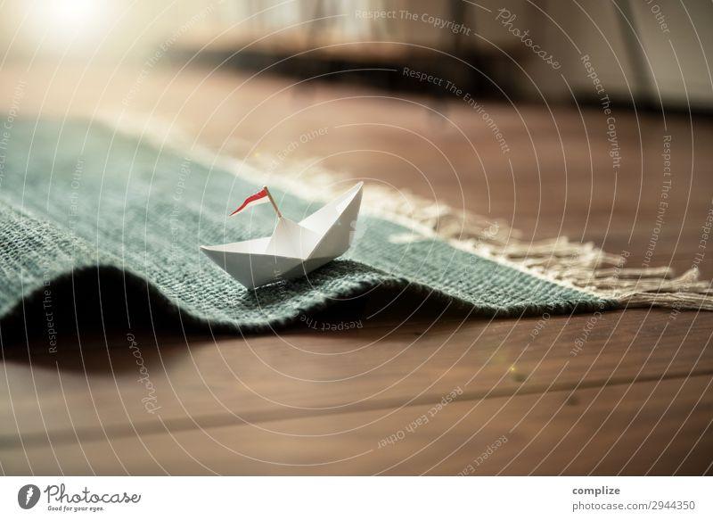 Kleines Papierschiff auf Teppich (Wellen) Lifestyle Freude Glück Gesundheit Wellness harmonisch Wohlgefühl Ferien & Urlaub & Reisen Kreuzfahrt Sommer