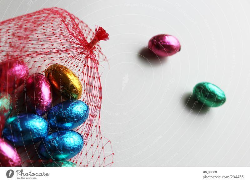 Im Netz Süßwaren Schokolade Essen Feste & Feiern Ostern Kindheit Verpackung Metall Netzwerk glänzend genießen leuchten ästhetisch blau mehrfarbig gold rosa rot