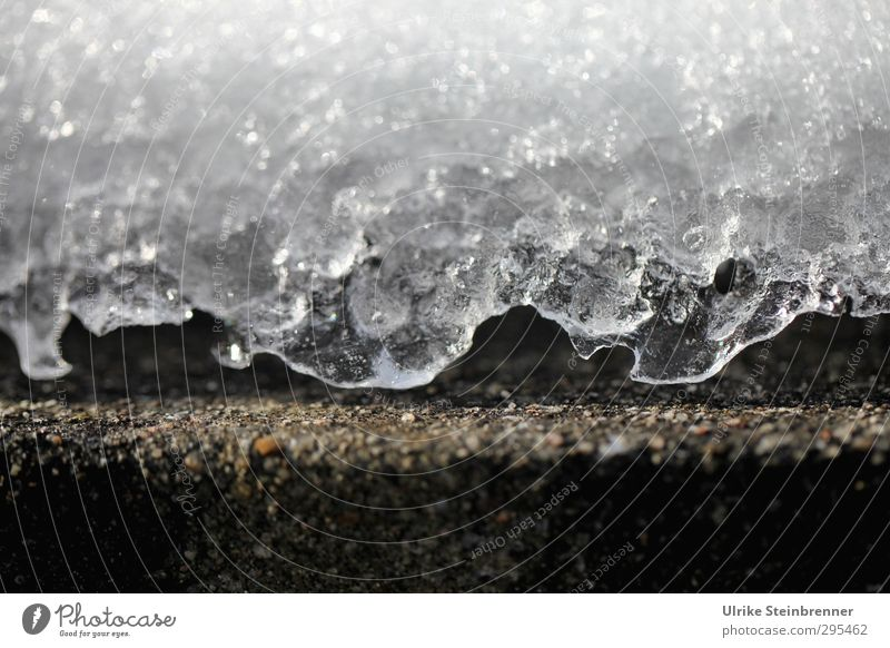 Schichtwechsel Wasser weiß Sonne Winter kalt Umwelt Wand natürlich Mauer grau Stein glänzend liegen Eis Klima Beton