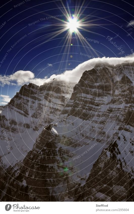 Schöner Winter Himmel Natur Ferien & Urlaub & Reisen blau Sonne Landschaft Wolken Berge u. Gebirge Schnee fliegen Felsen Luft Luftverkehr Ausflug Schönes Wetter