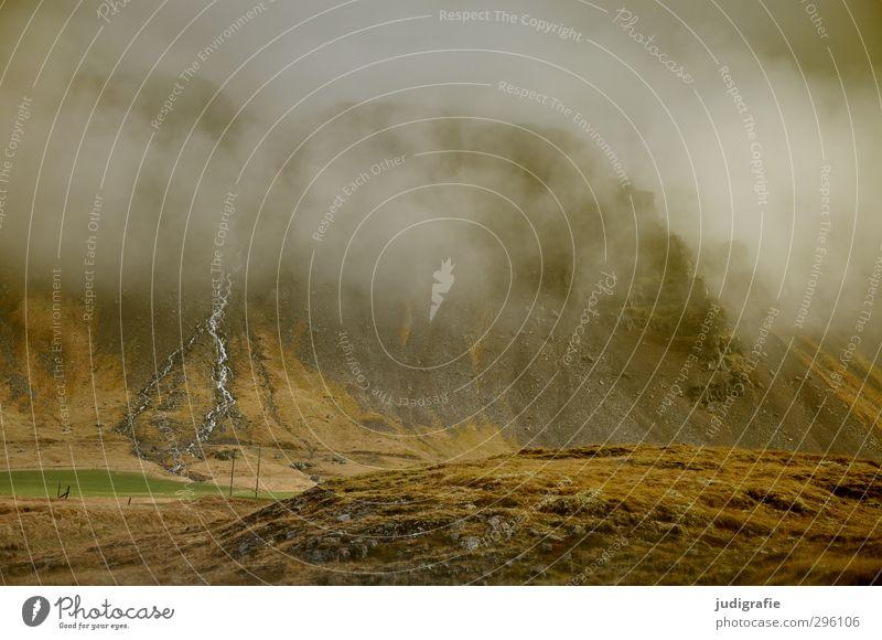 Island Umwelt Natur Landschaft Urelemente Wolken Klima Hügel Felsen Berge u. Gebirge außergewöhnlich bedrohlich dunkel natürlich wild braun Stimmung Farbfoto