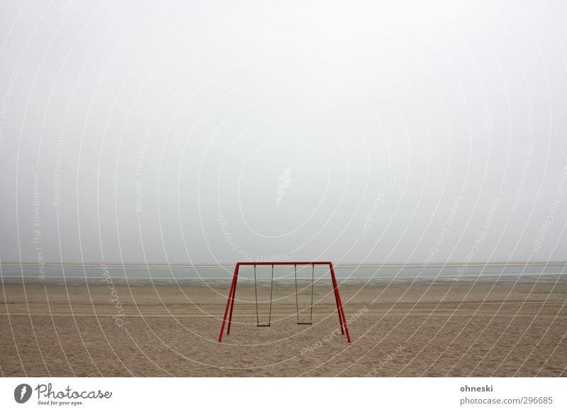 Playground Spielplatz Schaukel Sand schlechtes Wetter Küste Strand Nordsee Langeoog Menschenleer Einsamkeit Angst Endzeitstimmung Ferne Farbfoto Gedeckte Farben