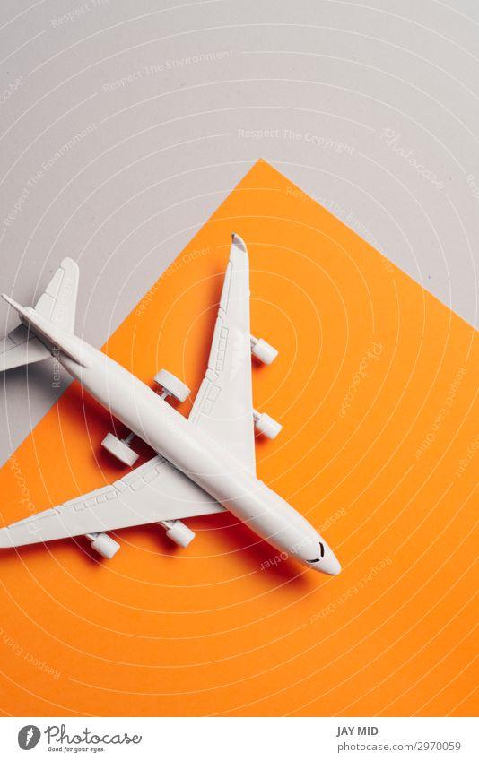 Jetflugzeug Reisekonzept, Minimal Art, oranger Hintergrund Design Leben Ferien & Urlaub & Reisen Tourismus Ausflug Sommer Business Kunst Himmel Verkehr