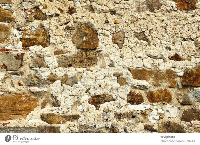 alte verwitterte Steinmauer Design Haus Felsen Architektur Fassade Beton Rost dreckig retro braun grau Wand Klotz Konsistenz Zement Material Oberfläche