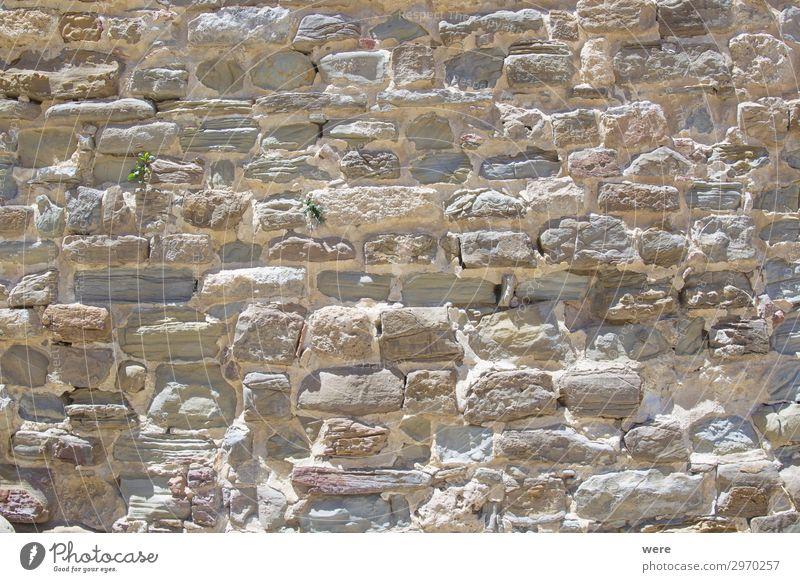 Historic stone wall on the Alcazar in Tarifa alt Hintergrundbild Wand Mauer fest