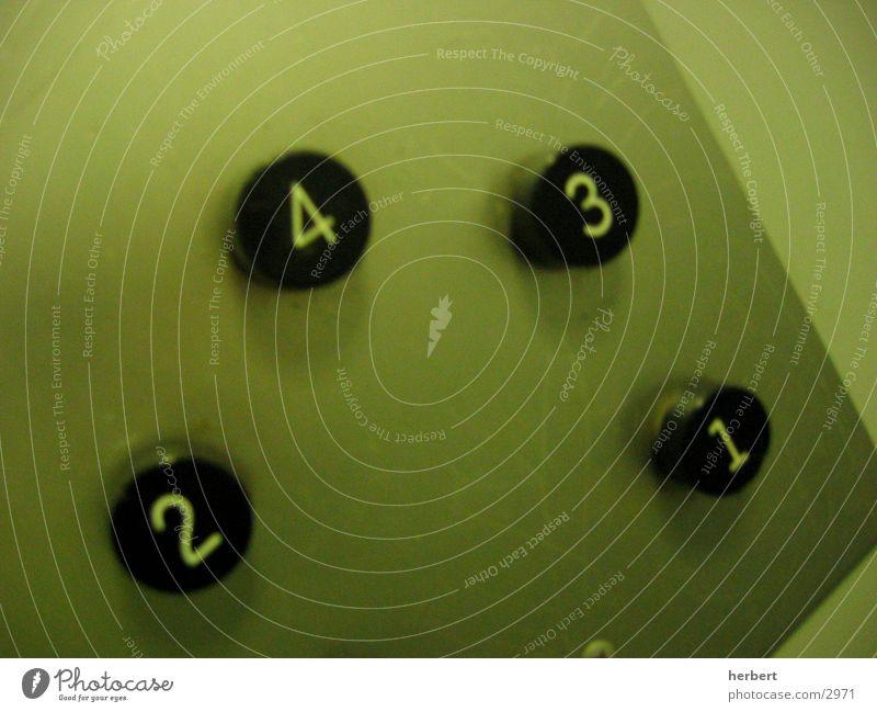 Lift Fahrstuhl Knöpfe grün Fototechnik Ziffern & Zahlen