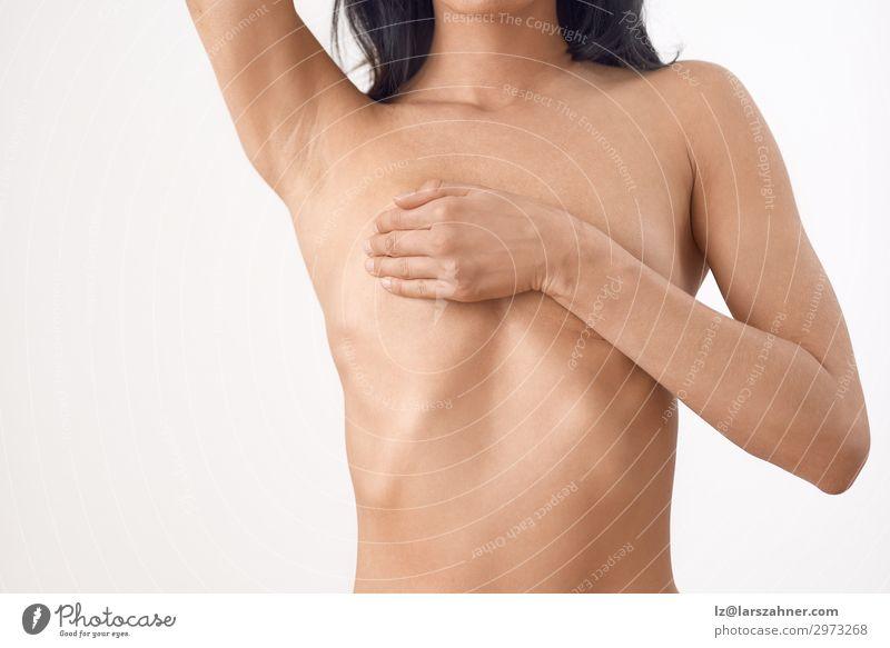 Torso einer schlanken nackten Frau mittleren Alters. schön Körper Haut Gesundheitswesen Medikament Prüfung & Examen Erwachsene Frauenbrust Hand berühren