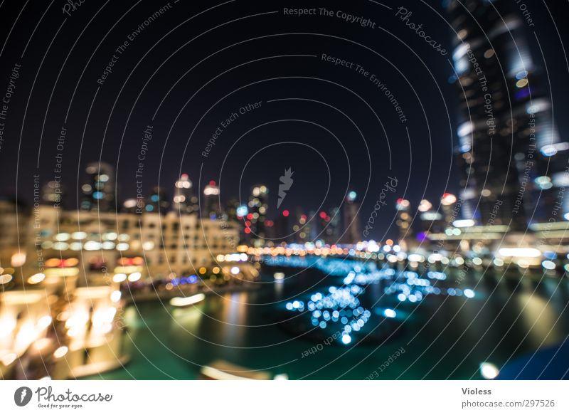 häähh? Brille wozu? Sehenswürdigkeit glänzend leuchten Bekanntheit verrückt Licht Unschärfe Dubai Burj Khalifa Farbfoto Experiment