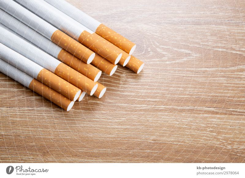 Cigarettes on a wooden background Lifestyle Rauchen cigarettes Ash Tobacco Nicotine smoke dependence pollutants dependent Health healthy Sick illness addiction