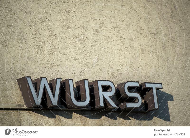Ist ja eh alles... Stadt Gebäude Mauer Wand Stein Metall Schriftzeichen trist braun Metzgerei Wurstwaren Ladengeschäft Leuchtreklame beige Farbfoto