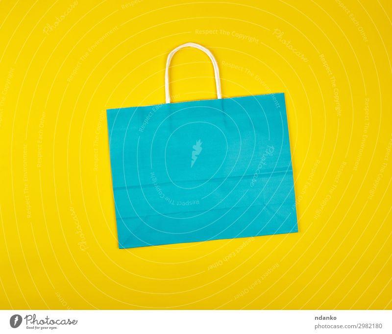 rechteckige blaue Papiertragetasche Lifestyle kaufen Stil Design Business Mode Verpackung Paket modern neu gelb Farbe Handel wirtschaftlich Hintergrund Tasche