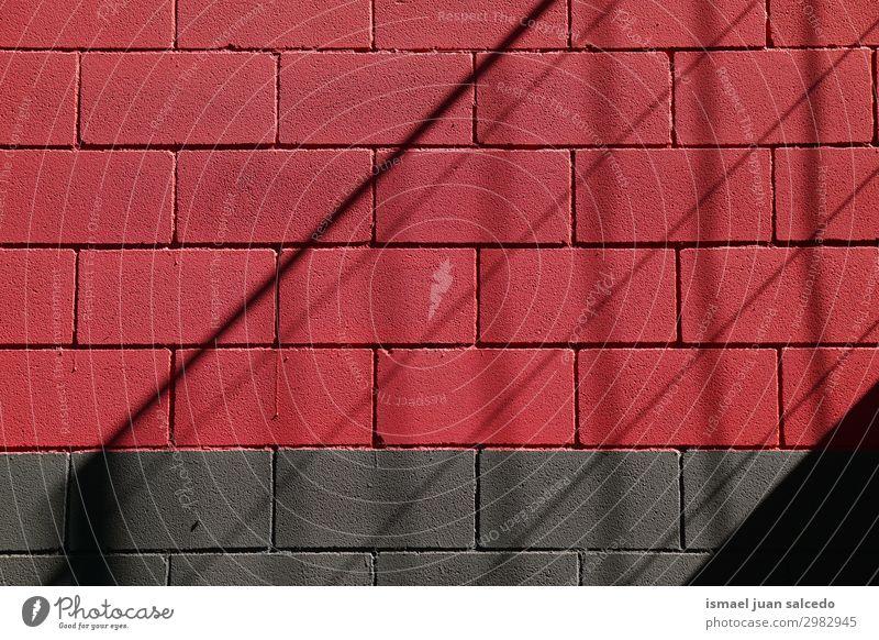 schwarzer und roter Wand abstrakter Hintergrund texturiert in der Straße Farbe mehrfarbig Konsistenz Muster Stein kaputt Architektur Strukturen & Formen
