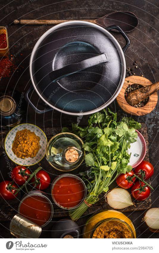Gusseisentopf mit Zutaten Gesunde Ernährung Foodfotografie Lebensmittel Hintergrundbild Stil Design frisch kaufen Dinge Kräuter & Gewürze Gemüse Gastronomie