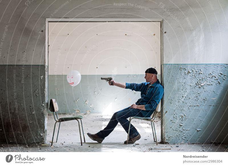 Die Dämonen im Visier Mensch maskulin Mann Erwachsene 1 Gebäude Architektur Mauer Wand Tür Jeanshose Mütze Luftballon Zeichen Jagd Aggression bedrohlich