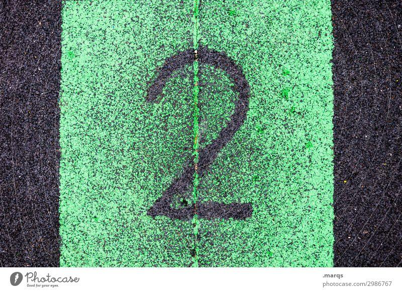 2 Erfolg Sportstätten Sportveranstaltung Kunststoff Ziffern & Zahlen authentisch grün schwarz zählen Farbfoto Außenaufnahme Nahaufnahme Strukturen & Formen