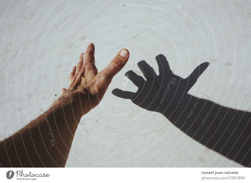 Mann Hand Schatten Silhouette an der Wand Finger Handfläche Körperteil Handgelenk Arme Haut Mensch Lichterscheinung Sonnenlicht gestikulieren Entwurf