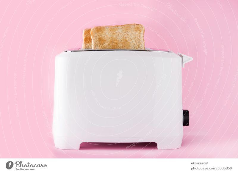 """Geröstetes Toastbrot im Toaster auf rosa Hintergrund Lebensmittel Brot Ernährung Frühstück Abendessen Bioprodukte Vegetarische Ernährung Fastfood gut """"Toast"""