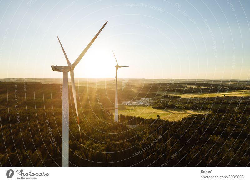 Wind Turbine in the sunset seen from an aerial view Himmel Natur Landschaft Wald Umwelt Energiewirtschaft Technik & Technologie Kraft Zukunft groß Klima