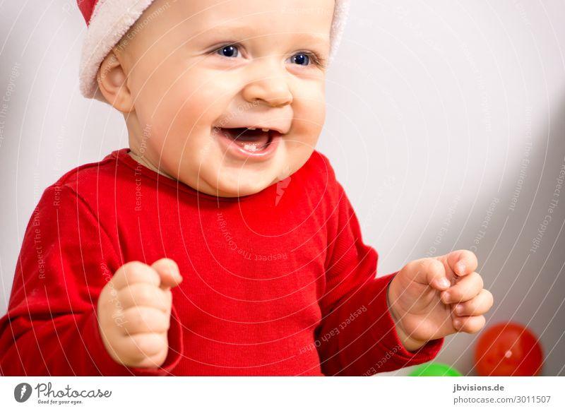 so happy Mensch maskulin Kind Kleinkind 1 1-3 Jahre Hut lachen sitzen Glück rot Freude Fröhlichkeit Lebensfreude Weihnachten & Advent Nikolausmütze Farbfoto