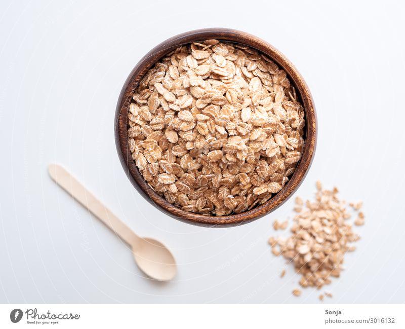 Haferflocken in einer Holzschüssel Lebensmittel Getreide Ernährung Frühstück Bioprodukte Slowfood Schalen & Schüsseln Löffel Kochlöffel Diät Gesundheit Billig