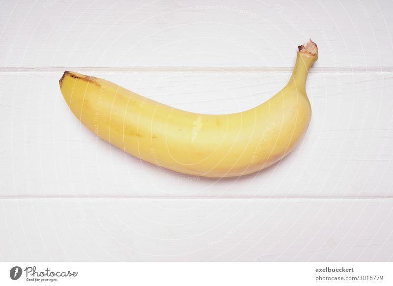 Banane Lebensmittel Frucht Ernährung Vegetarische Ernährung Gesunde Ernährung gelb Snack Vitamin Vegane Ernährung Vogelperspektive reif Südfrüchte Holztisch