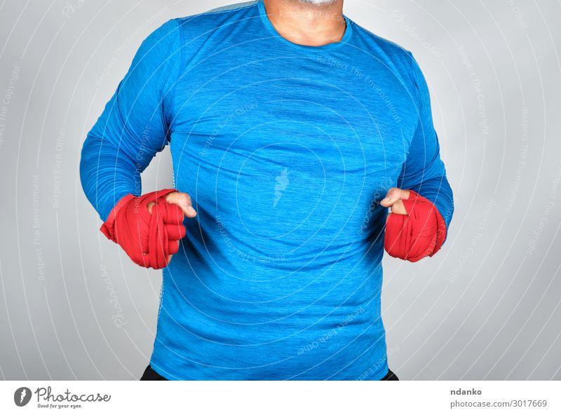 erwachsener Athlet in blauer Kleidung Lifestyle Körper sportlich Fitness Sport Sport-Training Mensch maskulin Mann Erwachsene Hand 1 30-45 Jahre stehen