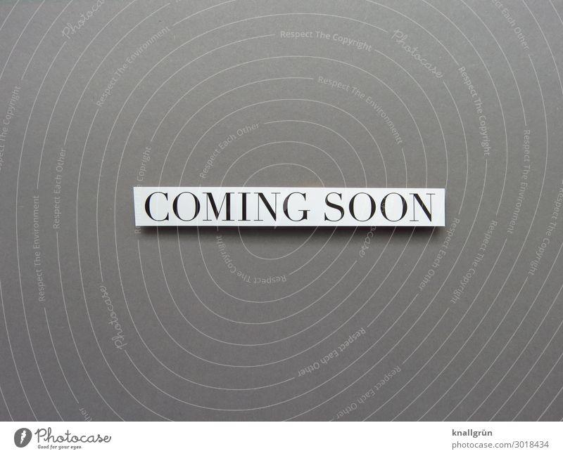 COMING SOON weiß schwarz Gefühle Zeit grau Schriftzeichen Kommunizieren Schilder & Markierungen Beginn Zukunft warten Neugier Vorfreude Interesse Erwartung
