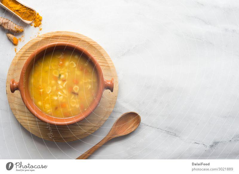 Kurkuma- und Gemüsesuppe Brot Suppe Eintopf Mittagessen Abendessen Vegetarische Ernährung Diät Schalen & Schüsseln Winter Herbst Holz heiß lecker gelb Tradition