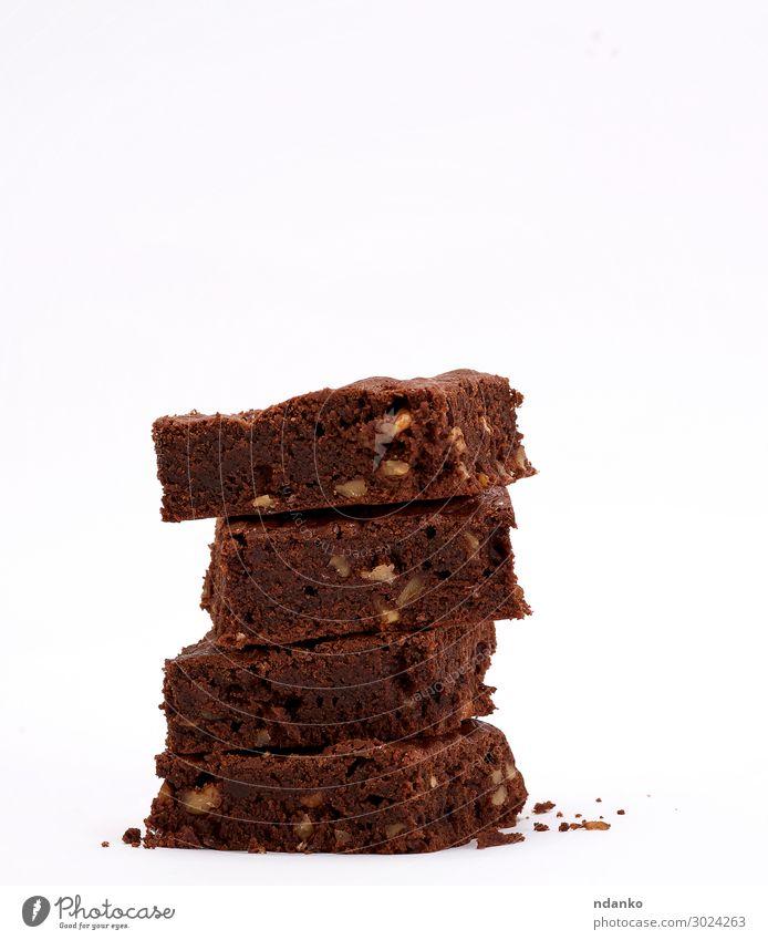 gebackener quadratischer Brownie Schokoladenkuchen mit Walnüssen Kuchen Dessert Kakao dunkel frisch lecker braun schwarz weiß Tradition Anhäufung Biskuit
