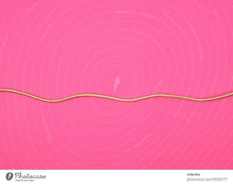 goldenes Kabel für Geräte in der Textilwicklung Telefon Computer Technik & Technologie Blitze Kunststoff Linie liegen modern neu rosa Kreativität Element