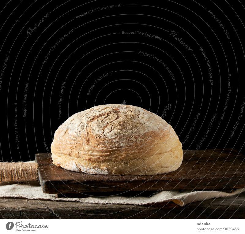 gebackenes rundes weißes Weizenbrot auf einem Textiltuch Brot Brötchen Ernährung Essen Frühstück Abendessen Tisch Küche Holz alt dunkel frisch natürlich braun