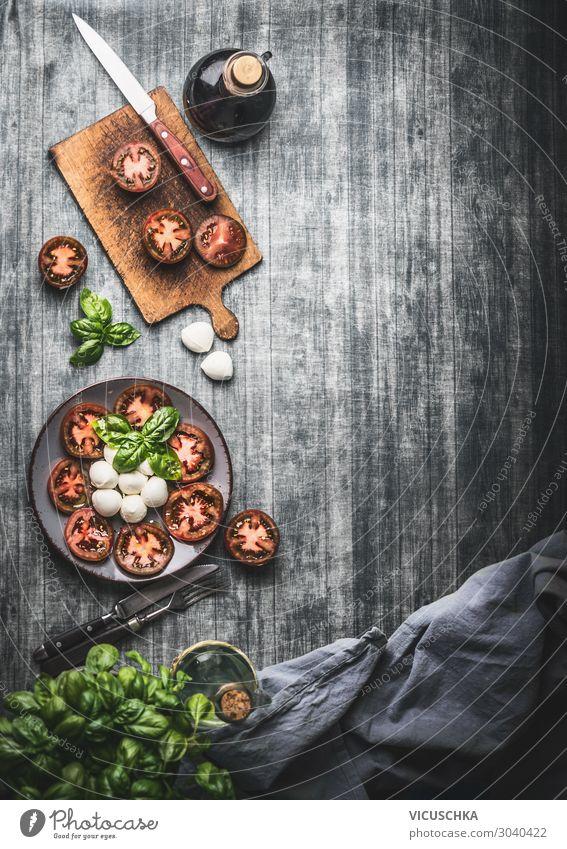 Hintergrund mit geschnittenen Tomaten und Mozzarella Lebensmittel Käse Gemüse Salat Salatbeilage Kräuter & Gewürze Ernährung Mittagessen Bioprodukte