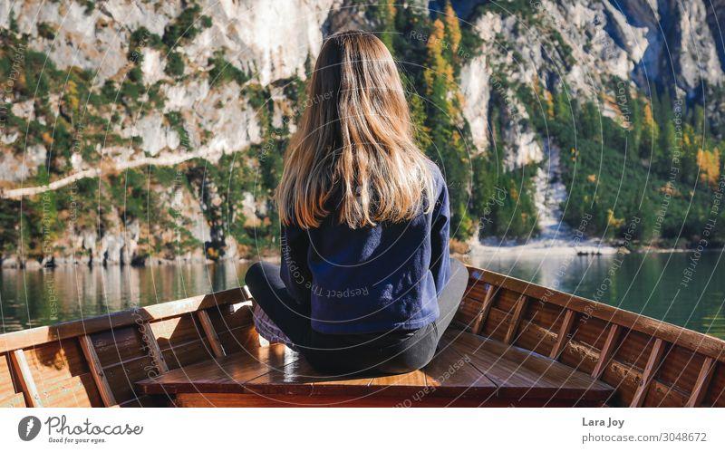 Girl from behind in wooden boat on mountain lake Ferien & Urlaub & Reisen Ausflug Abenteuer Ferne Expedition Berge u. Gebirge wandern feminin Mädchen Junge Frau