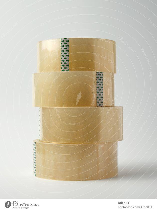 Stapel aus transparentem Klebeband Büro Werkzeug Verpackung Paket Kunststoff gelb weiß Klebstoff Hintergrund Garnspulen kreisen übersichtlich Versand Gerät Leim