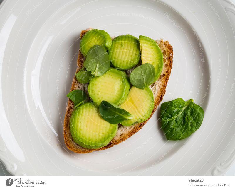 Avocadotoast auf einem Teller Gemüse Frucht Brot Ernährung Frühstück Mittagessen Vegetarische Ernährung frisch natürlich grün Amuse-Gueule Hintergrund Brunch