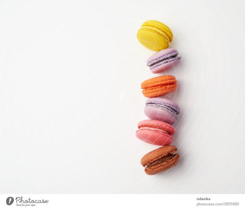 Stapel bunt gebackener Makronen Kuchen Dessert Süßwaren Essen frisch lecker oben braun gelb rosa weiß Farbe Tradition Vanille Wahl Mandel Zucker Sahne Geschmack