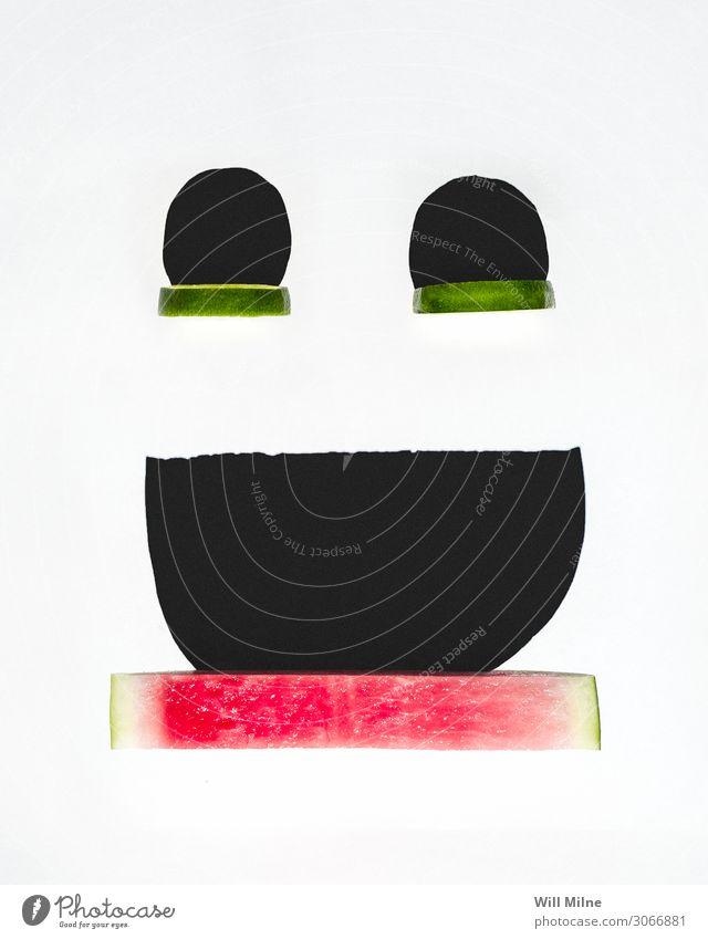 Smiley-Gesicht aus Früchten und Schatten Lächeln Wassermelone Frucht Limone grün rot Glück sehr wenige Fröhlichkeit