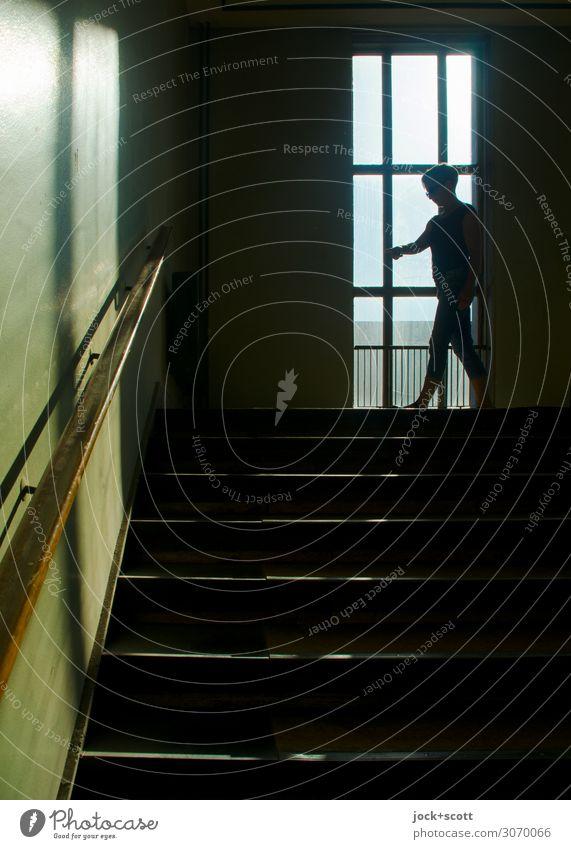 Blick im Treppenhaus  (1600 St.) feminin Mensch DDR Wärme Treptow Bürogebäude Fenster Treppengeländer Bewegung gehen lang oben retro Gefühle Stimmung