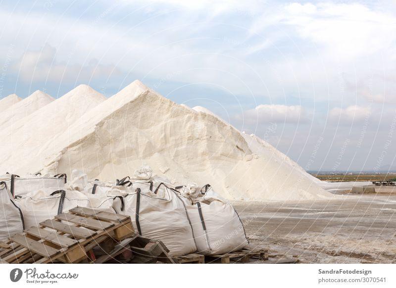 Salt hills of a salt plantation on Majorca Ferien & Urlaub & Reisen Ausflug Natur entdecken blue sky pans Saline salty mountain sea ingredient heap factory