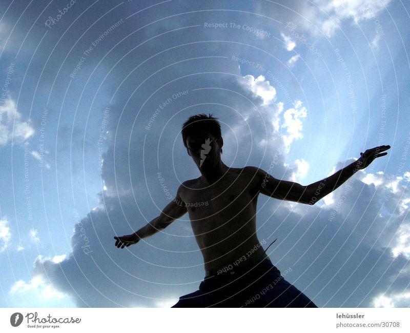 schattenmann Mensch Mann Himmel Sonne Wolken springen