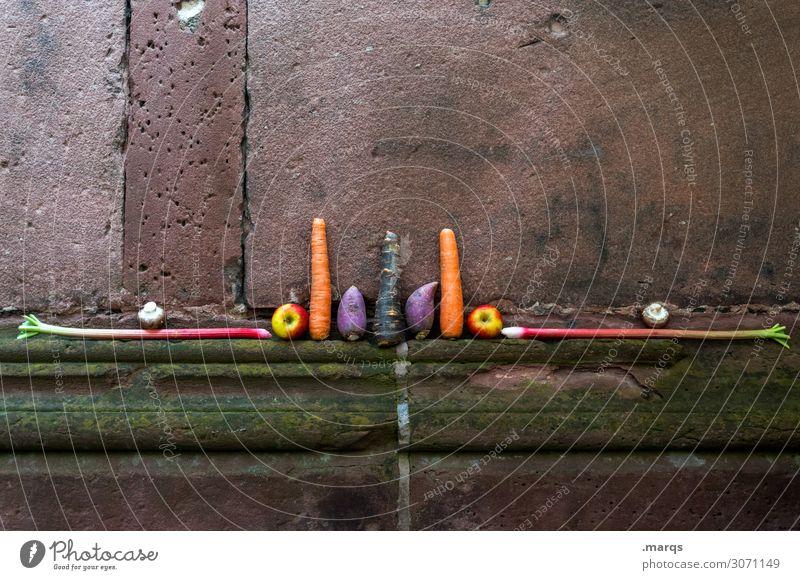 Gemüsealtar Lebensmittel Apfel Möhre Rhabarber Pilz Ernährung Bioprodukte Vegetarische Ernährung Mauer Wand außergewöhnlich Gesundheit Ordnung skurril Symmetrie