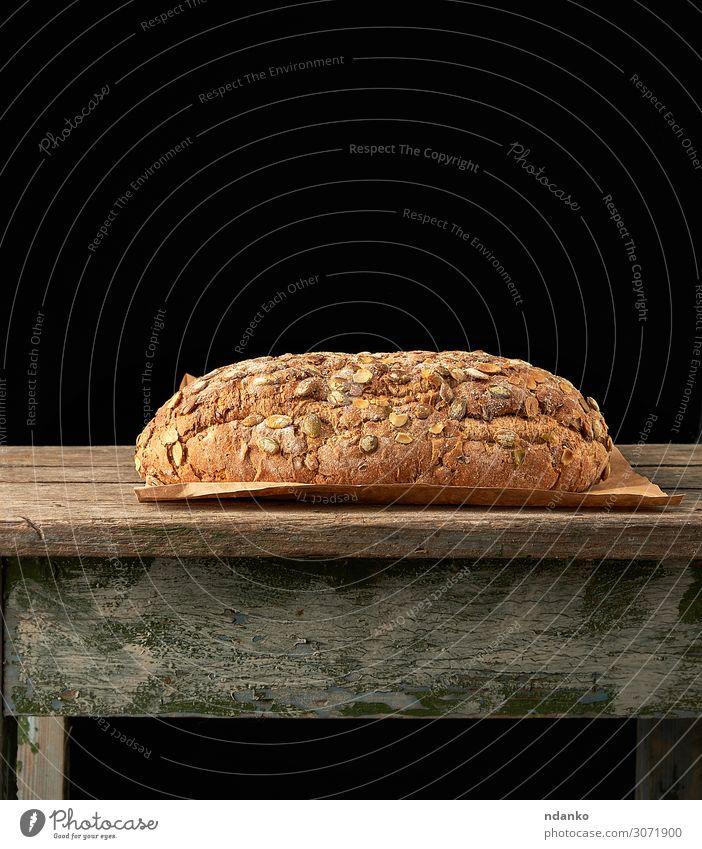 Brot aus Roggenmehl mit Kürbiskernen Ernährung Frühstück Diät Tisch Holz frisch oben braun grau Tradition backen Bäckerei Lebensmittel Feinschmecker Korn