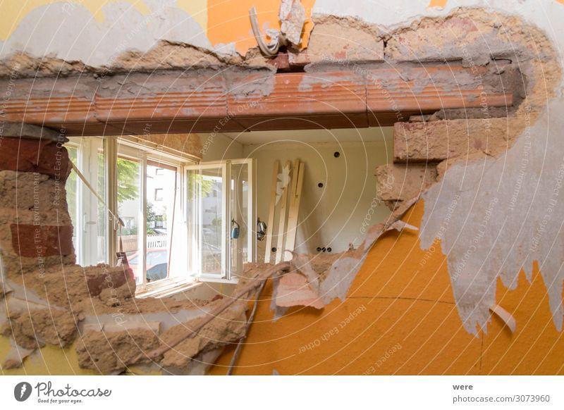 Old wall with started wall breakthrough Handwerker Baustelle Mauer Wand Arbeit & Erwerbstätigkeit bauen Beginn chaotisch Tabubruch Construction site
