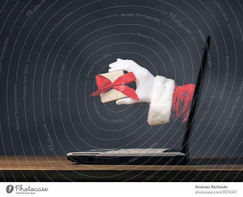 Hand of Santa with a gift box Winter Veranstaltung Weihnachten & Advent Notebook Internet Mensch Tradition online Weihnachtsmann modern ecology Hintergrundbild